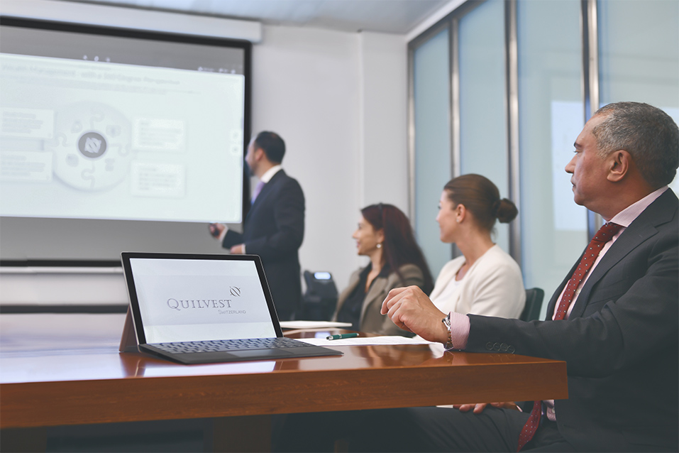 People sitting in a meeting during a presentation.